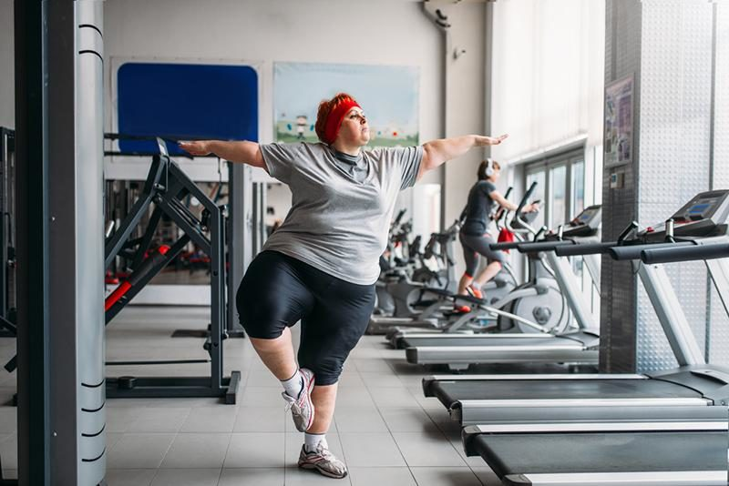 fat-woman-doing-balance-exercise-in-gym