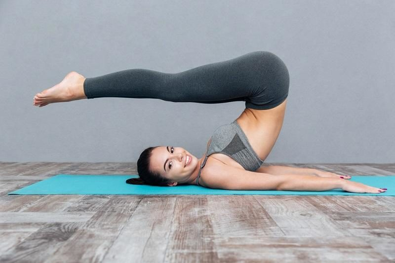 young-girl-doing-yoga-exercise-halasana-plow-pose