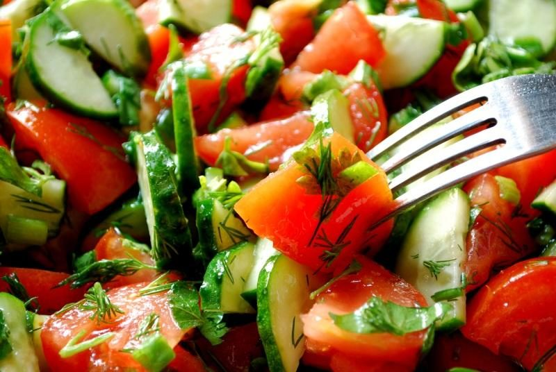 salad-of-tomatoes-and-cucumbers-with-fork