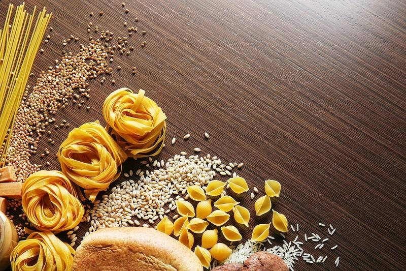 set-of-products-with-complex-carbohydrates-on-wooden-background