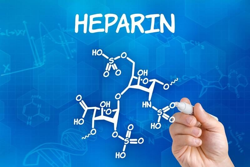 hand-with-pen-drawing-the-chemical-formula-of-heparin