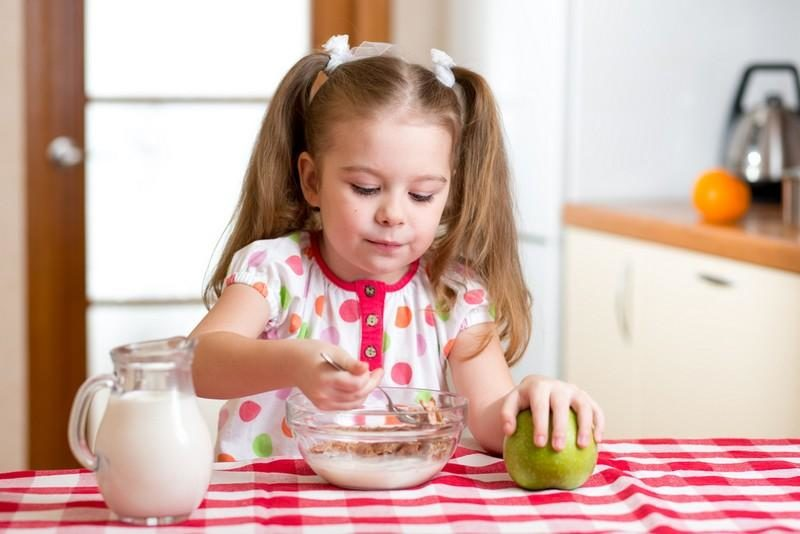child-eating-healthy-food-in-kitchen