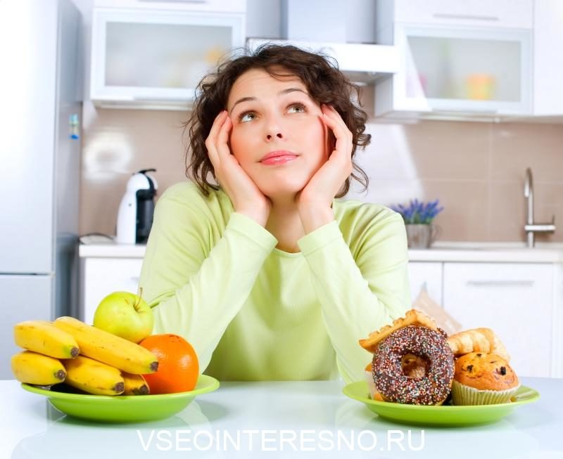 beautiful-young-woman-choosing-between-fruits-and-sweets