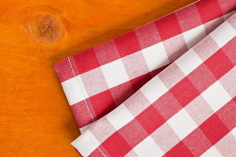 checkered-napkin-on-wooden-table